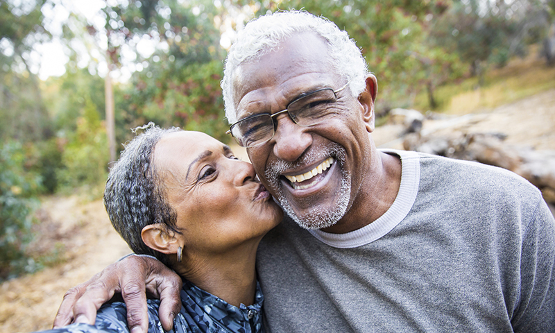 Happy older couple smiling after buying final expense insurance